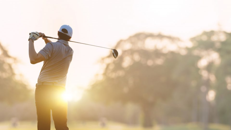 Golfer,He's,Golfing,In,Sunlight,Of,The,Morning.,View,From